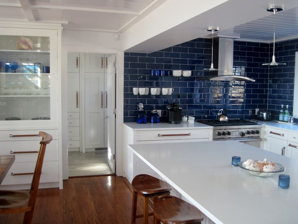 Kitchen - contemporary kitchen idea in Other with stainless steel appliances and subway tile backsplash