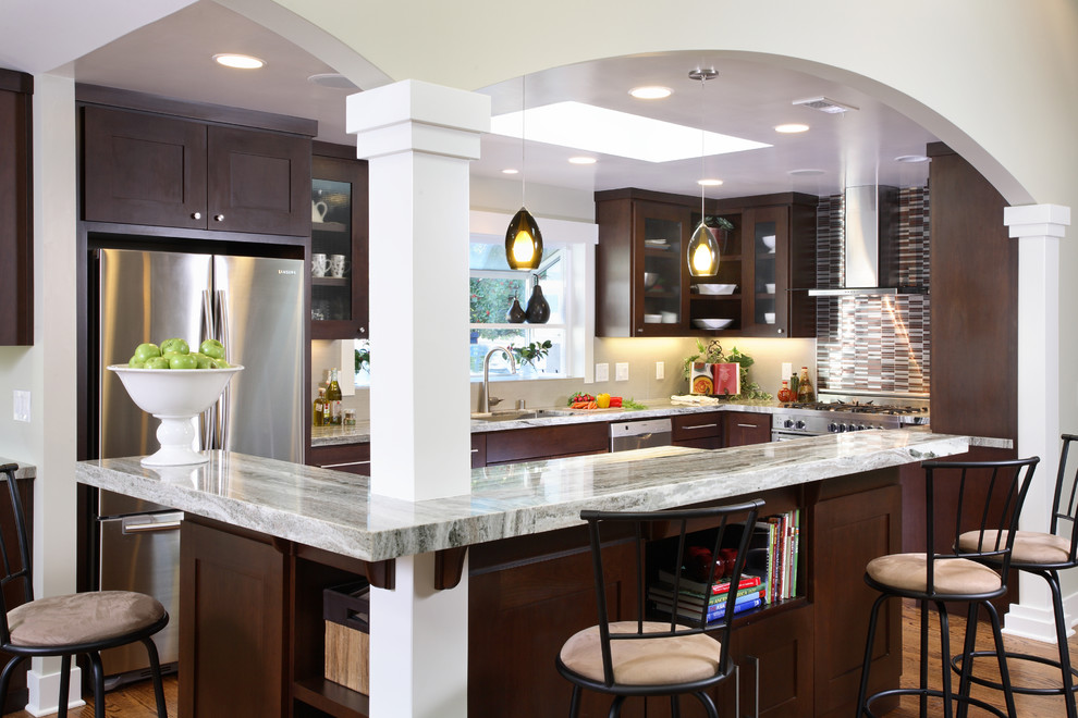 Trendy l-shaped kitchen photo in San Francisco with stainless steel appliances, glass-front cabinets, dark wood cabinets, quartzite countertops, matchstick tile backsplash and multicolored backsplash