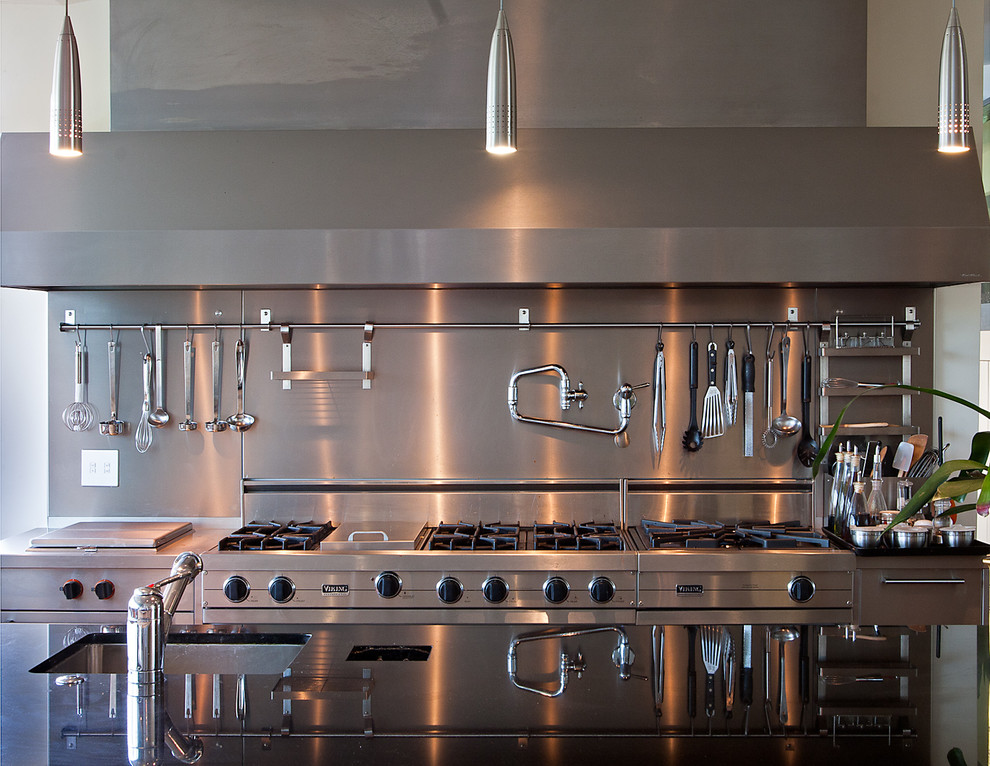 Kitchen - contemporary kitchen idea in San Francisco with stainless steel appliances, a single-bowl sink and metallic backsplash