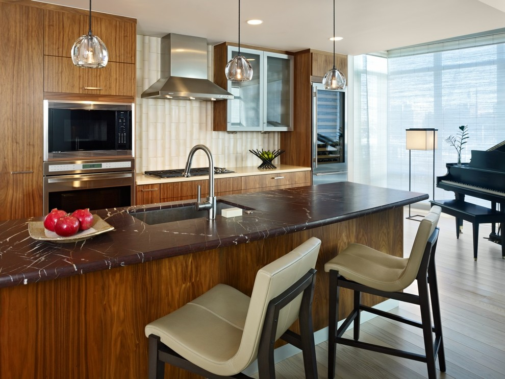 Example of a trendy kitchen design in Denver with stainless steel appliances