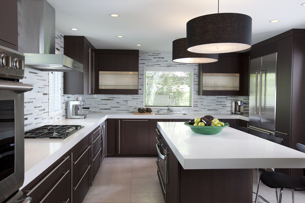 Kitchen - contemporary u-shaped kitchen idea in New York with matchstick tile backsplash, stainless steel appliances, flat-panel cabinets, dark wood cabinets, quartz countertops and multicolored backsplash