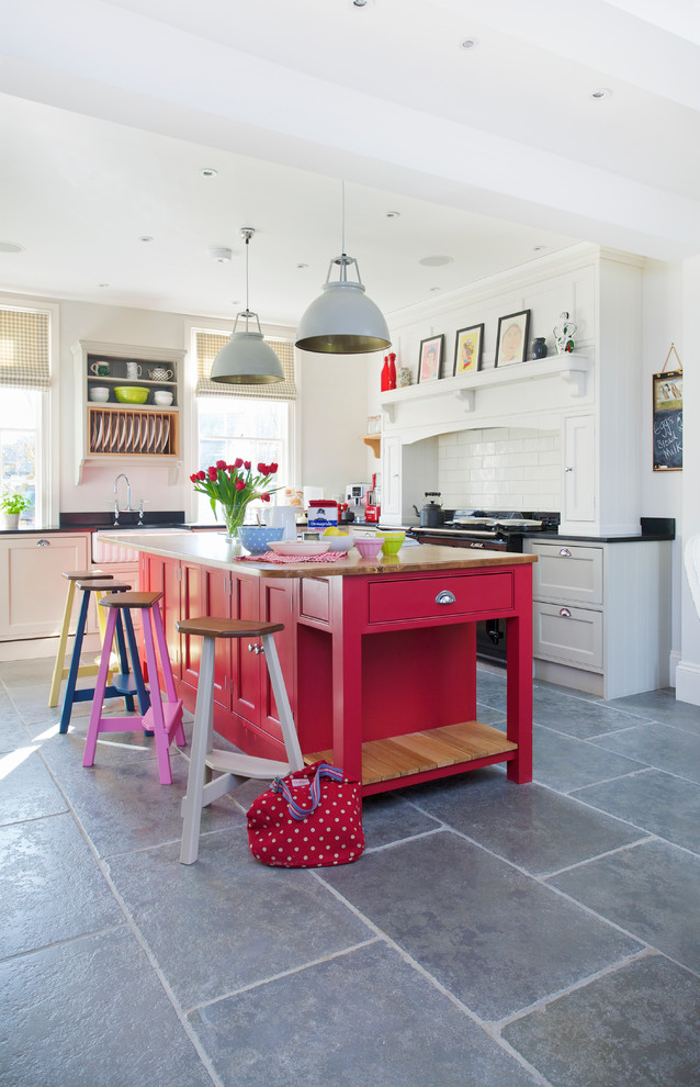 Inspiration for a transitional kitchen remodel in Kent with red cabinets, wood countertops, white backsplash, subway tile backsplash and an island