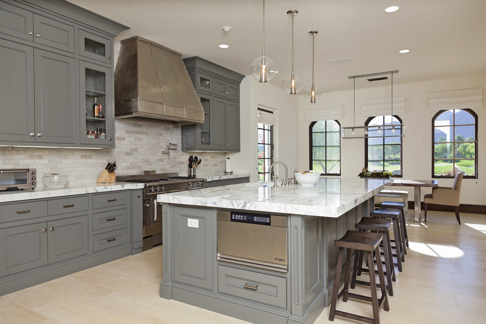 Trendy eat-in kitchen photo in San Diego with beaded inset cabinets, gray cabinets, gray backsplash, stainless steel appliances, marble countertops and travertine backsplash