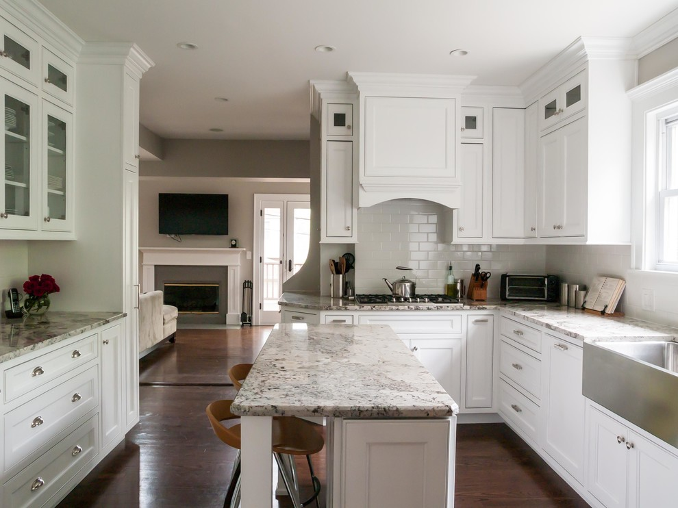 Enclosed kitchen - traditional enclosed kitchen idea in Chicago with stainless steel appliances, subway tile backsplash, a farmhouse sink, recessed-panel cabinets, white cabinets, granite countertops and white backsplash