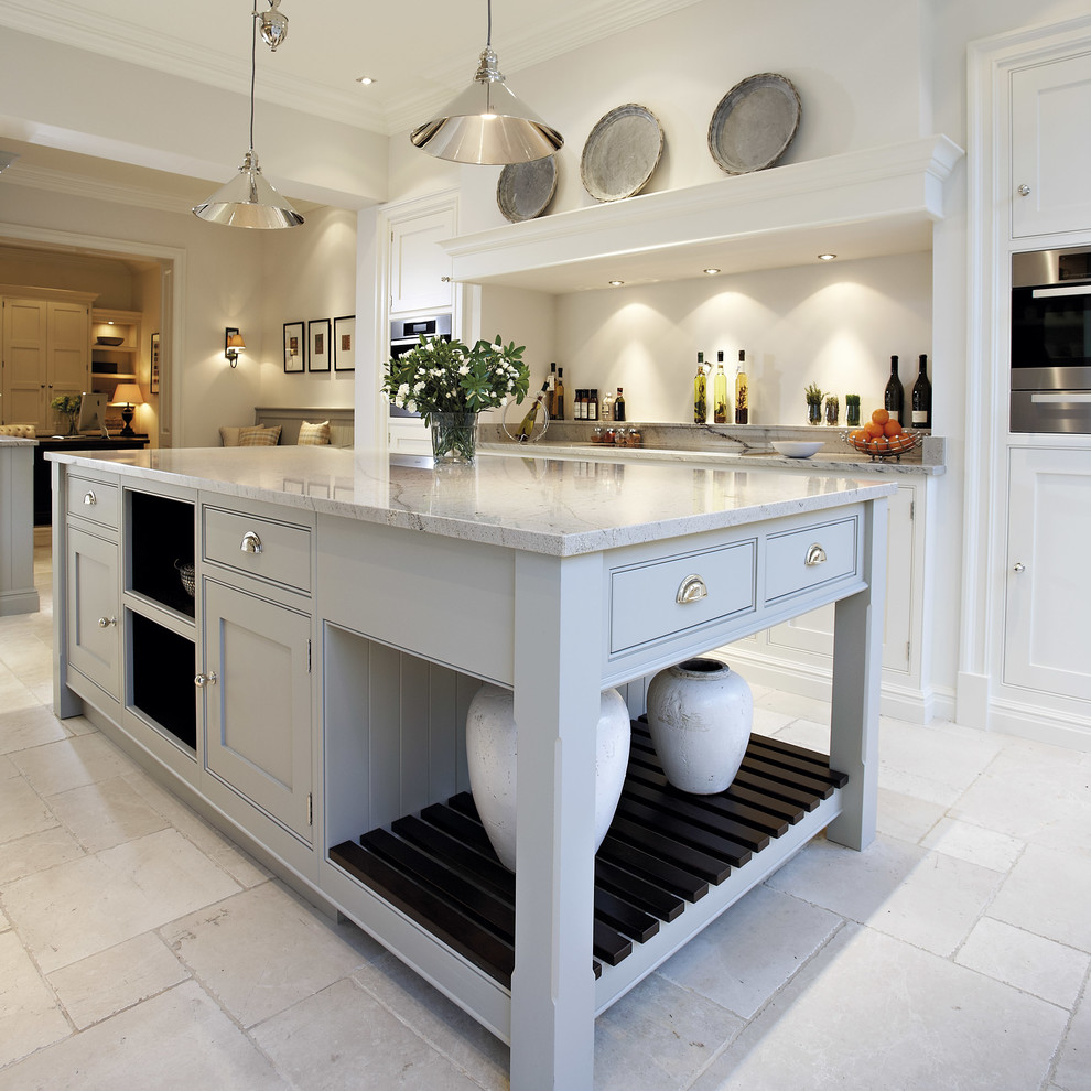 Example of a mid-sized marble floor open concept kitchen design in Manchester with gray cabinets, granite countertops, stainless steel appliances, an island and beaded inset cabinets