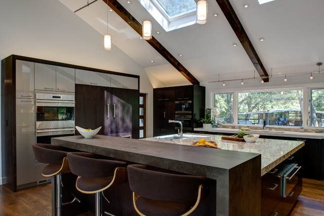 Huge trendy l-shaped dark wood floor eat-in kitchen photo in San Francisco with an undermount sink, flat-panel cabinets, dark wood cabinets, quartz countertops, blue backsplash, mosaic tile backsplash, stainless steel appliances and an island