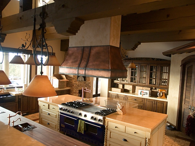 Copper island kitchen hood with iron straps  Traditional  Kitchen
