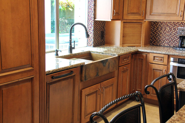 Kitchen with rustic patina copper apron front workstation