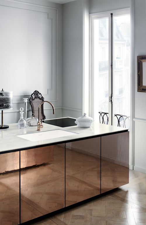 A perfect example of the thin thickness countertop trend in a modern kitchen design.