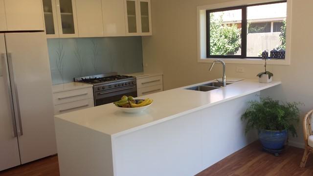 Corian Benchtops with Dezignatek White Gloss cabinetry
