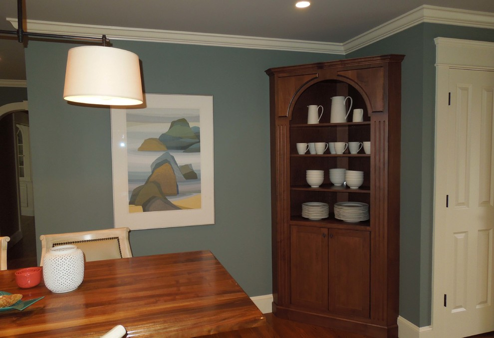 Inspiration for a mid-sized timeless l-shaped medium tone wood floor open concept kitchen remodel in Charleston with a single-bowl sink, beaded inset cabinets, white cabinets, granite countertops, brown backsplash, stainless steel appliances and an island