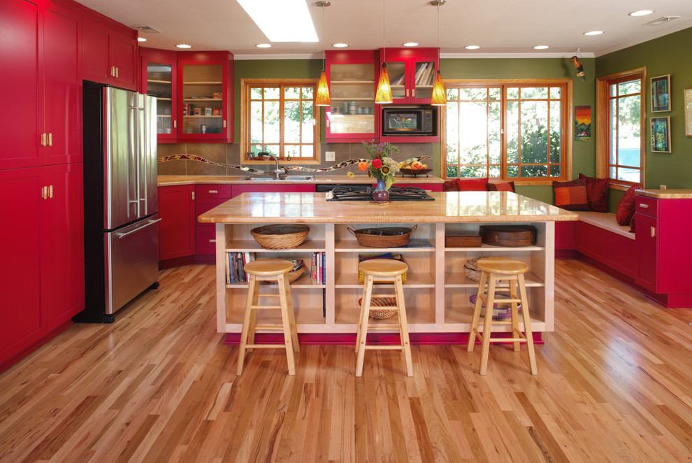 Example of a transitional kitchen design in Portland with red cabinets
