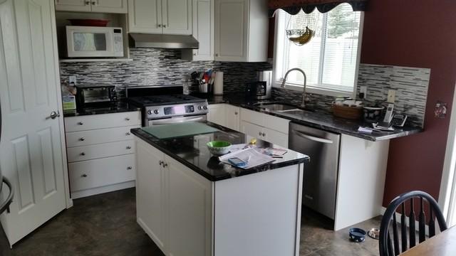 Cosmic Black Granite Kitchen/Vanities/Fireplace - Modern - Kitchen