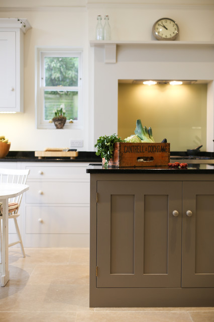 Mid-sized trendy single-wall eat-in kitchen photo in Other with shaker cabinets, white cabinets, granite countertops and an island