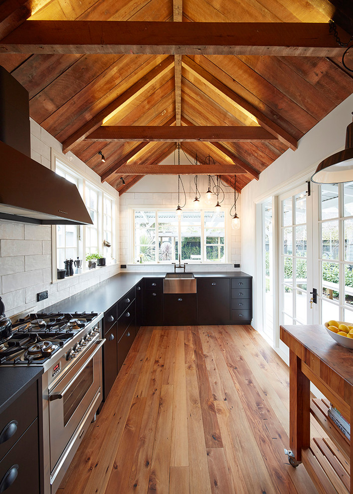 Inspiration for an industrial kitchen remodel in Auckland