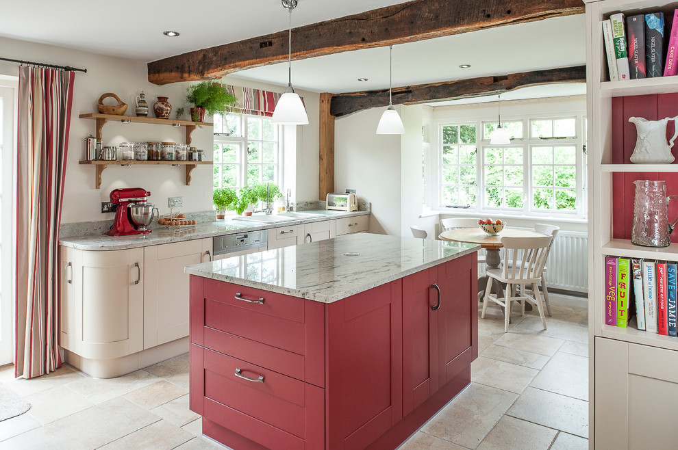 Example of a large cottage porcelain tile eat-in kitchen design in Kent with a double-bowl sink, red cabinets, granite countertops, paneled appliances and an island