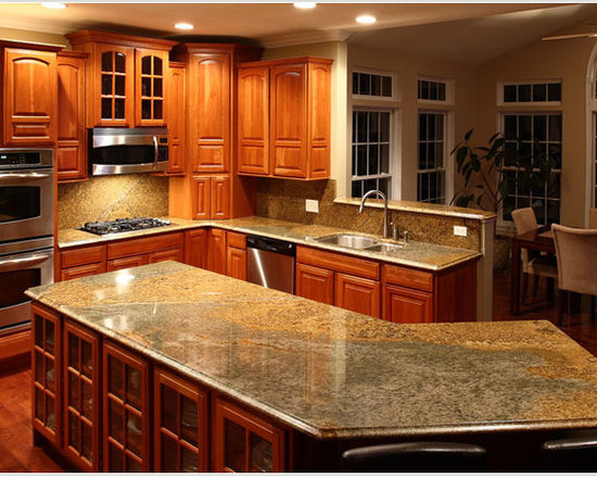 Stainless Steel Appliances, Brown Cabinets and Light Wood Cabinets