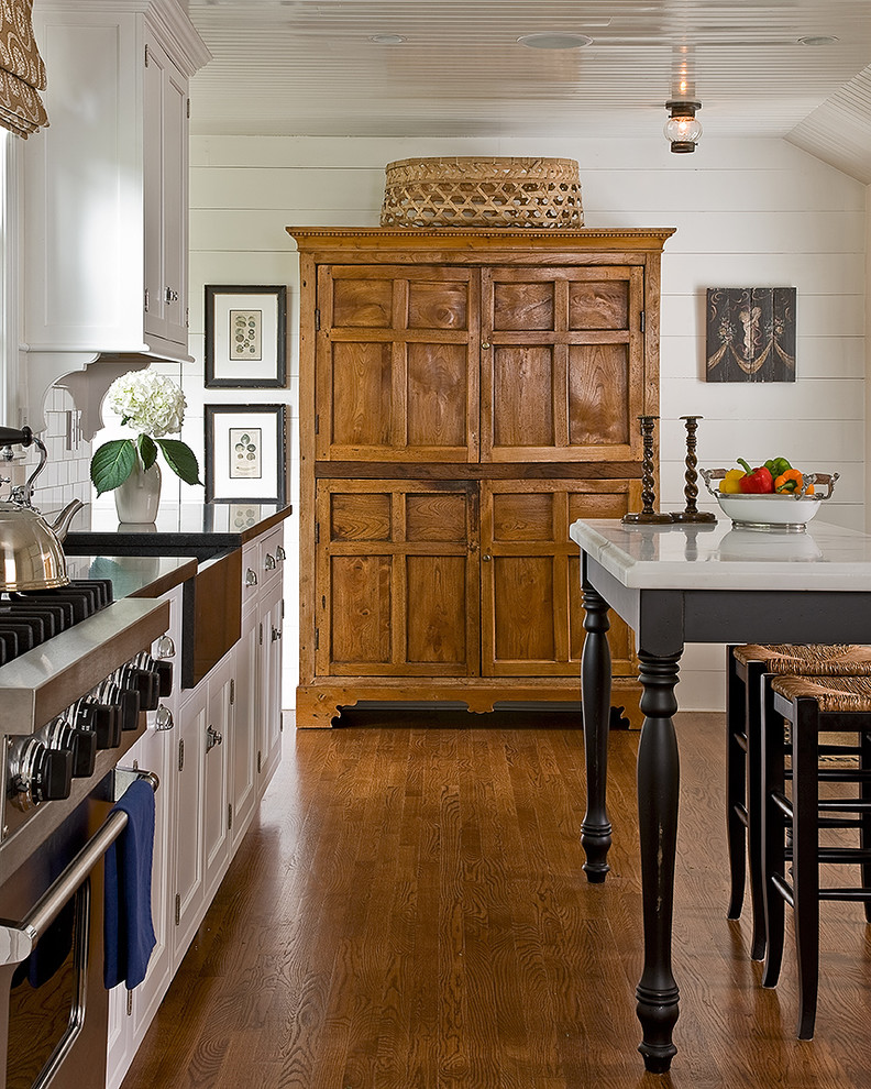 Inspiration for a timeless kitchen remodel in Boston with stainless steel appliances and a farmhouse sink