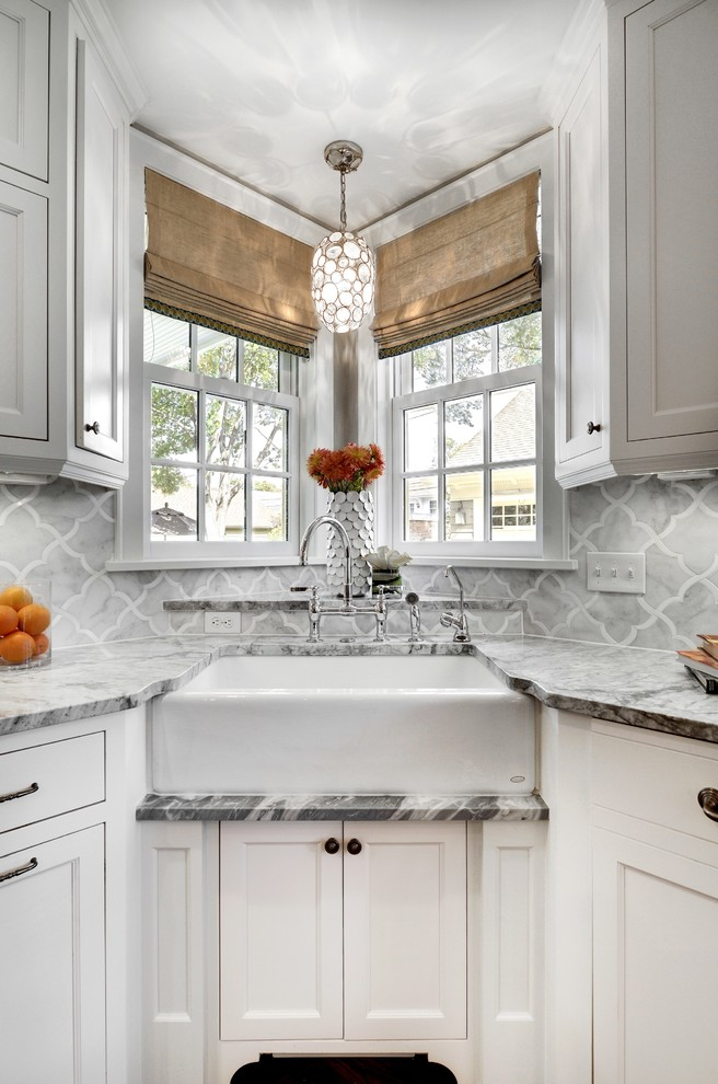 Example of a transitional kitchen design in Minneapolis with a farmhouse sink, recessed-panel cabinets, white cabinets, gray backsplash and marble backsplash