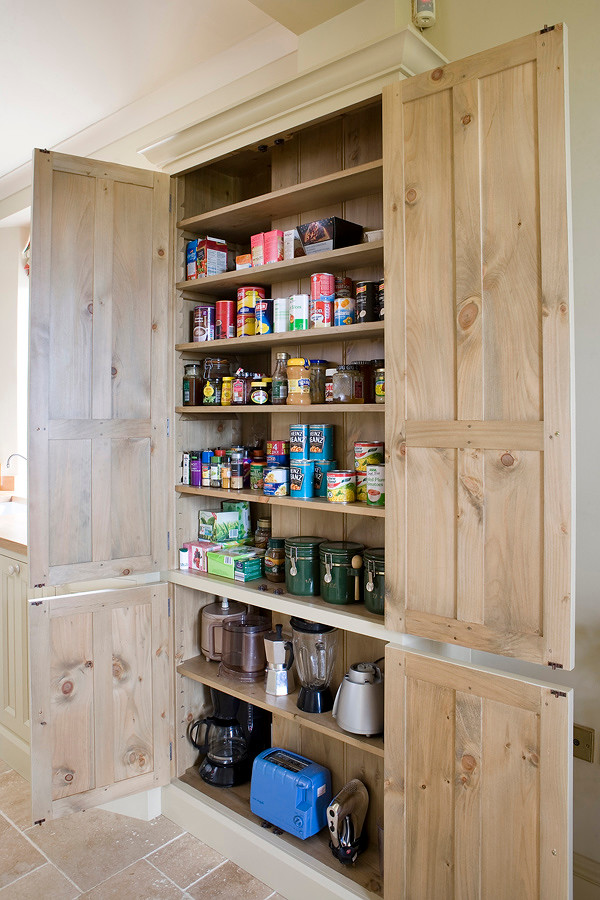 Kitchen - farmhouse kitchen idea in Other with beaded inset cabinets and wood countertops