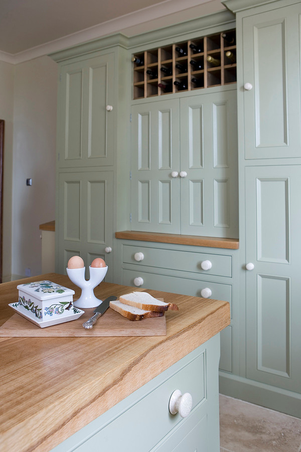 Country kitchen photo in Other with beaded inset cabinets and wood countertops