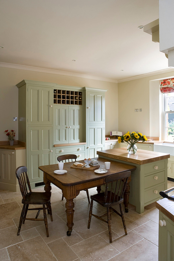 Kitchen - cottage kitchen idea in Other with beaded inset cabinets and wood countertops