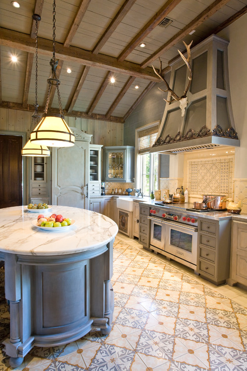 Modern french country kitchen featuring large range