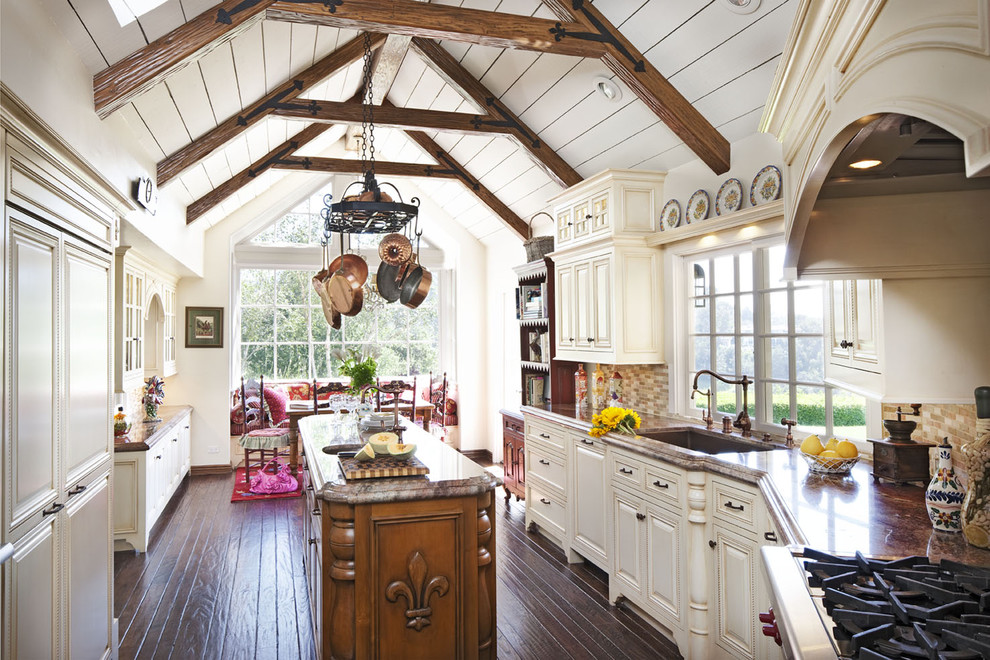 Inspiration for a timeless u-shaped dark wood floor eat-in kitchen remodel in Los Angeles with raised-panel cabinets, beige cabinets, an undermount sink, multicolored backsplash, matchstick tile backsplash, stainless steel appliances and an island