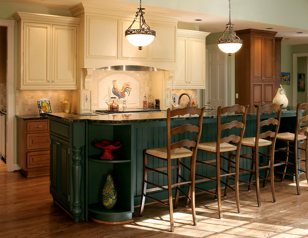 Example of a mountain style kitchen design in Portland with raised-panel cabinets, beige cabinets and beige backsplash
