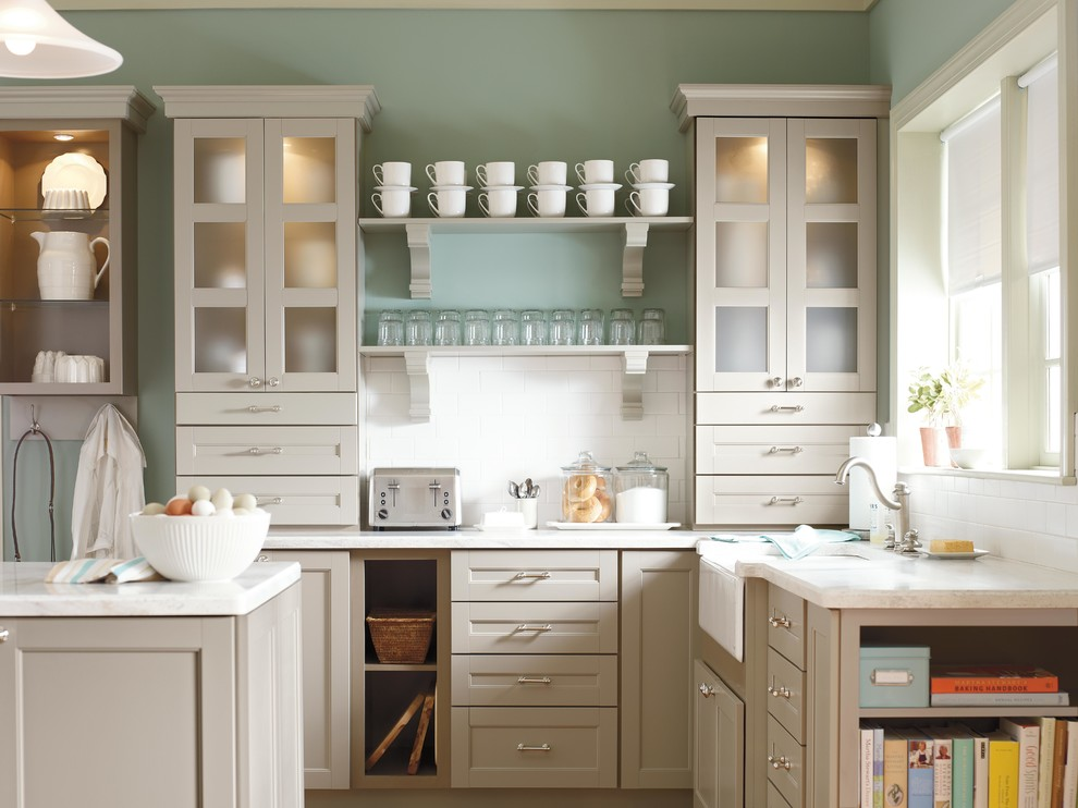 Eat-in kitchen - small farmhouse l-shaped eat-in kitchen idea in New York with shaker cabinets, gray cabinets, solid surface countertops, white backsplash, subway tile backsplash and an island