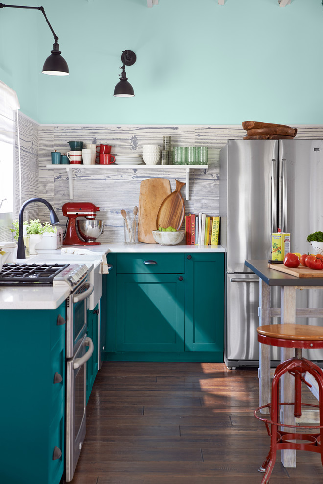 Inspiration for a small coastal l-shaped brown floor and medium tone wood floor kitchen remodel in New York with a farmhouse sink, shaker cabinets, turquoise cabinets, quartz countertops, gray backsplash, porcelain backsplash, stainless steel appliances, an island and white countertops