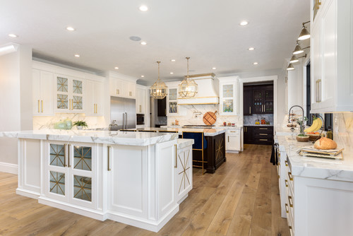 Large double island kitchen in white and gold hardware fixtures