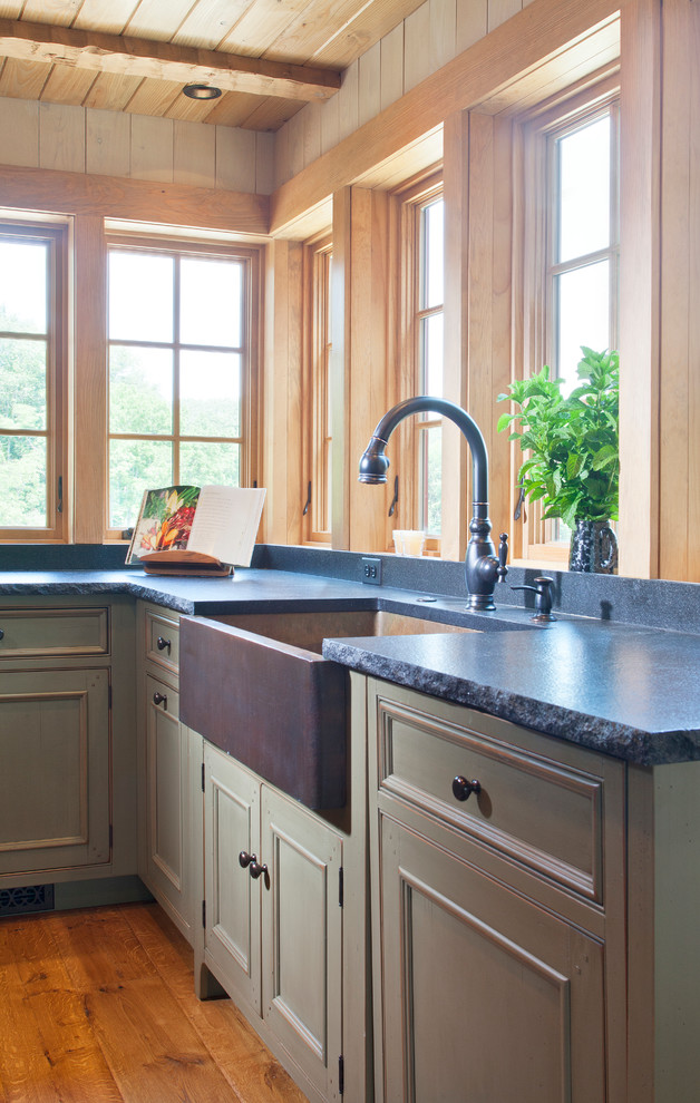 Eat-in kitchen - farmhouse u-shaped eat-in kitchen idea in DC Metro with a farmhouse sink, flat-panel cabinets, wood countertops, black backsplash, stone slab backsplash and stainless steel appliances