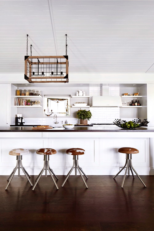 Modern kitchen featuring four backless stool with a cowhide design pattern on the seats
