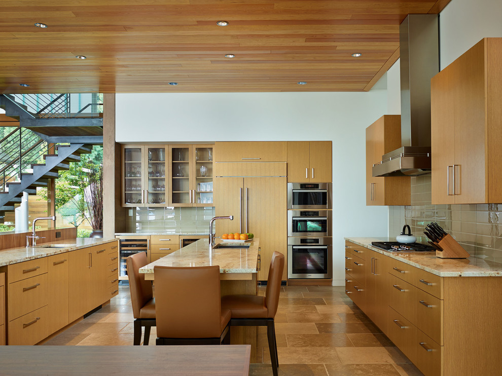 Inspiration for a contemporary kitchen remodel in Seattle with flat-panel cabinets, granite countertops and paneled appliances