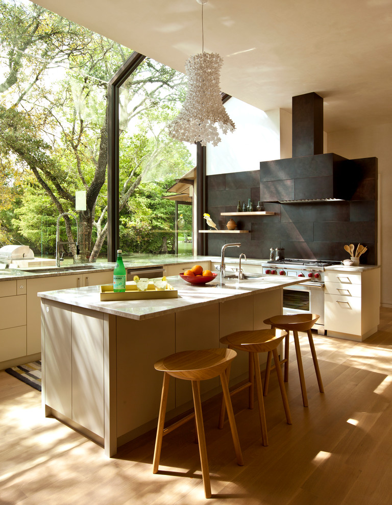Kitchen - contemporary kitchen idea in Austin with flat-panel cabinets, beige cabinets and metal backsplash