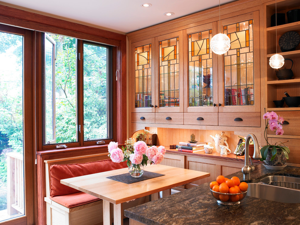 Inspiration for a craftsman kitchen remodel in Toronto with a double-bowl sink, glass-front cabinets and medium tone wood cabinets
