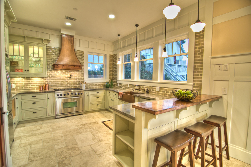 Example of an arts and crafts kitchen design in Orange County