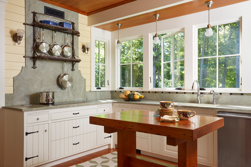 Beach style l-shaped kitchen photo in Minneapolis with white cabinets, stone slab backsplash, stainless steel appliances, an island, wood countertops and gray backsplash