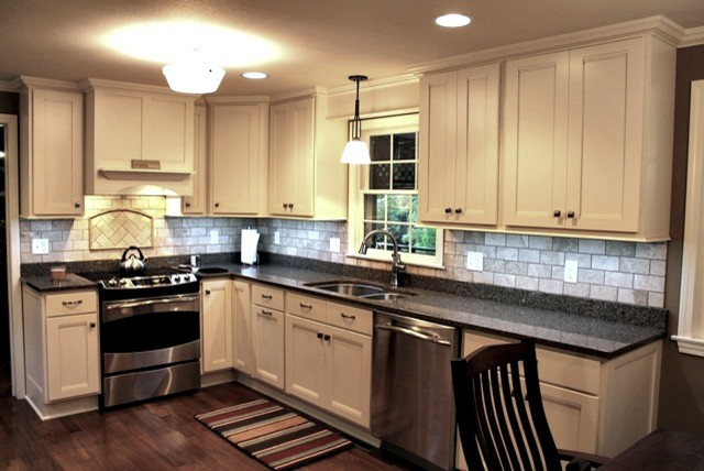 Creamy Kitchen Maple Cabinets And Quartz Counter Tops