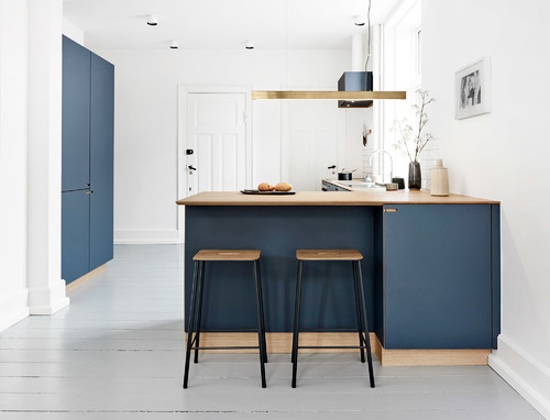 A blue and white painted kitchen design with a simple, Scandinavian Styled Look.