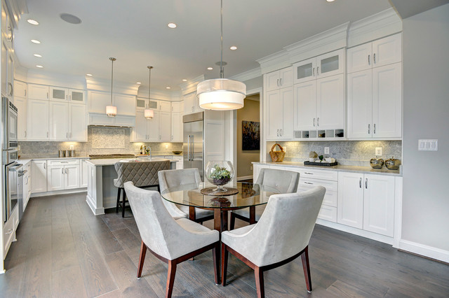 Inspiration for a transitional u-shaped dark wood floor eat-in kitchen remodel in DC Metro with an undermount sink, shaker cabinets, white cabinets, marble countertops, white backsplash, stone tile backsplash, stainless steel appliances and an island
