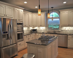 Kitchen with too much oak for Cathedral arch kitchen cabinets