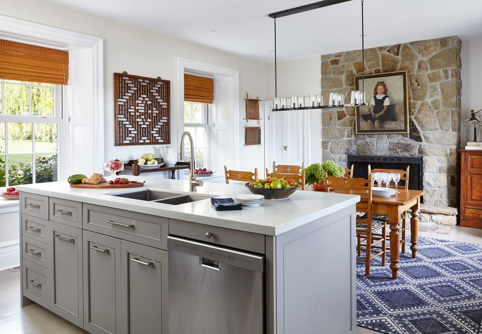 Small elegant galley light wood floor eat-in kitchen photo in Other with recessed-panel cabinets, gray cabinets, solid surface countertops, a double-bowl sink, stainless steel appliances and an island