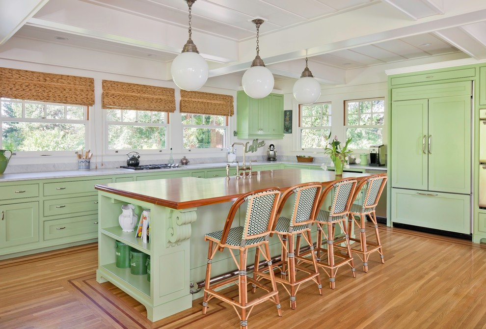 Kitchen - traditional kitchen idea in San Francisco with green cabinets, wood countertops, paneled appliances and shaker cabinets