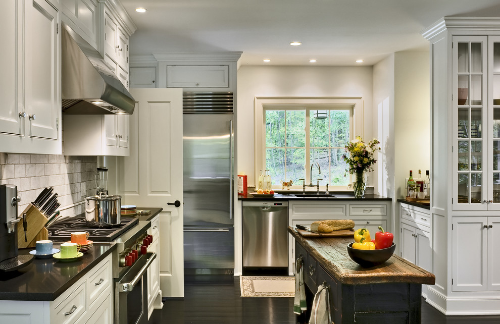 Inspiration for a timeless l-shaped eat-in kitchen remodel in New York with recessed-panel cabinets, white cabinets, white backsplash, subway tile backsplash, stainless steel appliances, an undermount sink and granite countertops
