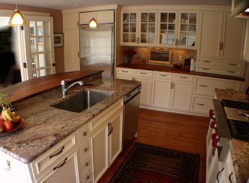 Kitchen island featuring granite countertops