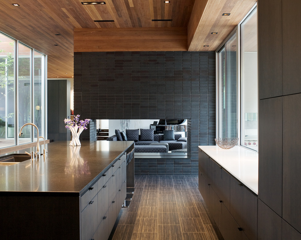 Inspiration for a contemporary open concept kitchen remodel in Kansas City with an undermount sink, flat-panel cabinets and gray cabinets