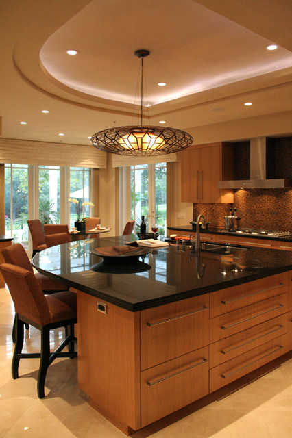 Kitchen - contemporary travertine floor kitchen idea in San Francisco with an undermount sink, flat-panel cabinets, medium tone wood cabinets, granite countertops, brown backsplash, stainless steel appliances and an island