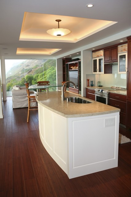 Curved Kitchen Island With Custom Lighted Tray Ceiling